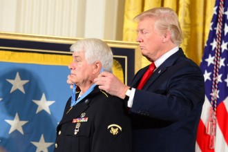 President Donald Trump drapes WMU alumnus James McCloughan with the Medal of Honor at the White House.