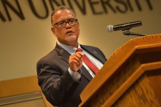 WMU President Edward Montgomery speaking at the podium during Fall Convocation 2017.