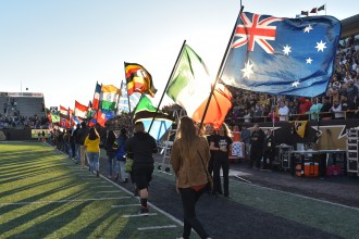 Photo of the homecoming football game's annual Parade of Flags.