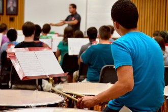 Photo of a Seminar Music Camp participant playing timpani.