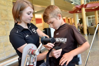 Photo of WMU OT student with a patient.