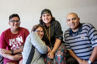 A family poses together in the WMU residence halls.
