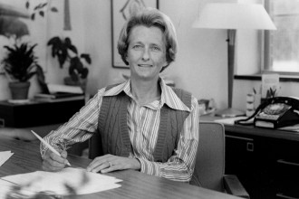 Helen J. Flaspohler sits behind her desk at WMU.