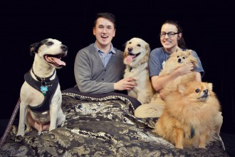 WMU theatre students pose on-stage with a few dogs.