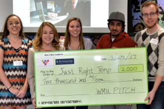 Students holding a giant prize check.
