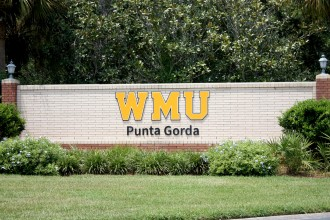 Brick entrance sign reads: WMU Punta Gorda.