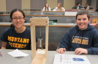 Students with Science Olympiad physics event