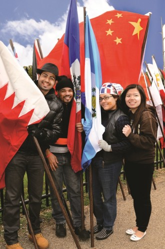 Photo of WMU students holding international flags