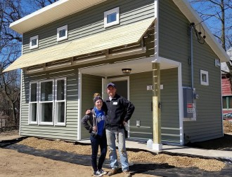 WMU student volunteer with Habitat for Humanity