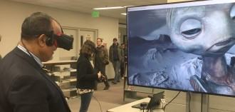 Person trying virtual reality at Waldo Library.