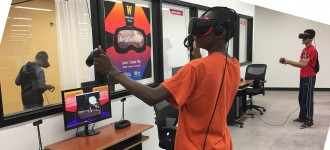 Student playing virtual reality in Waldo Library.