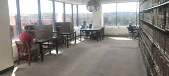 Tables and chairs in study space at Waldo Library.