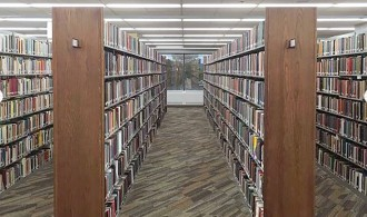 Bookshelves on first floor of Waldo Library after renovation.