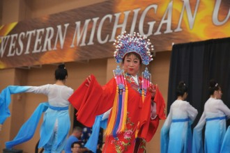 Chinese dance group performing a traditional Chinese dance in the WMU Recreation Center at the 2015 China Festival