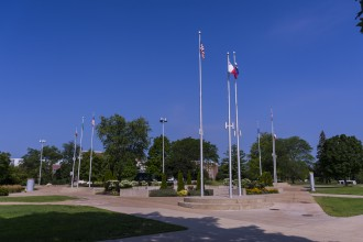 Western Michigan University celebrates the diversity of the campus population by rotating national flags at the set of flagpoles located in the center of main campus.