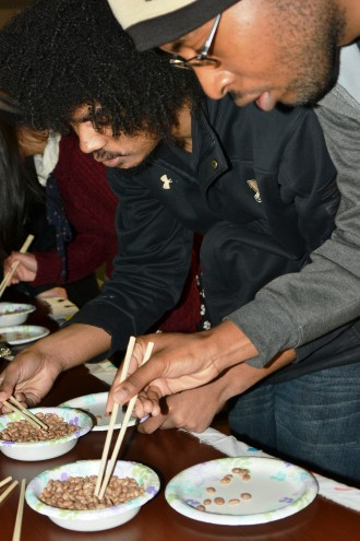 WMU students compete to see who has the best chopsticks skills during International Education Week.