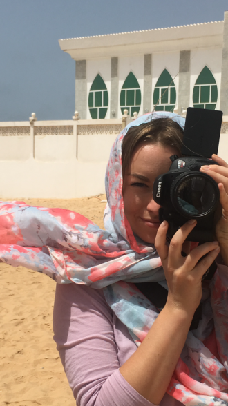 Student takes a photo of a student taking a photo in Senegal
