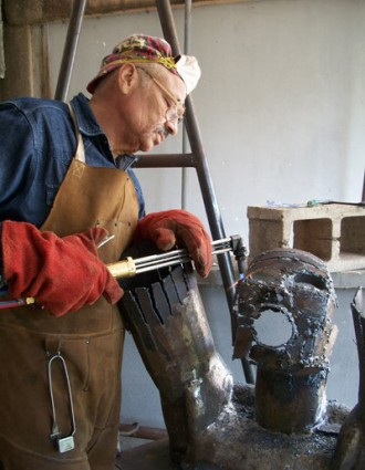 Retired WMU professor Albert LaVergne works on a metal scultpure.