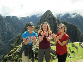 Photo of three WMU students abroad in a mountainous region.