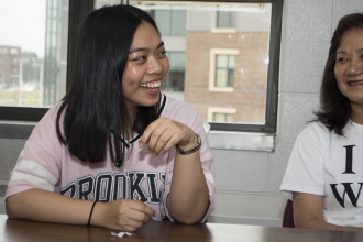 A WMU international student smiles during a CELCIS conversation circle event.