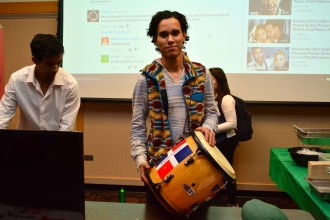 A Dominican Republic student shows off traditional Dominican drums.