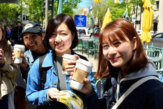 Exchange students enjoy coffee at a local cafe.