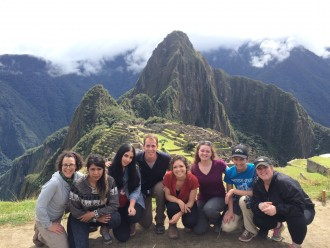 A group of WMU students pose for a photo at the top of Macchu Picchu in Peru.