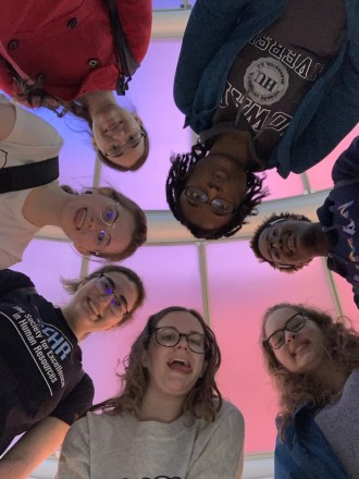 6 students, including Aya Miller, circled around the camera from below taking a fun photo in Portugal