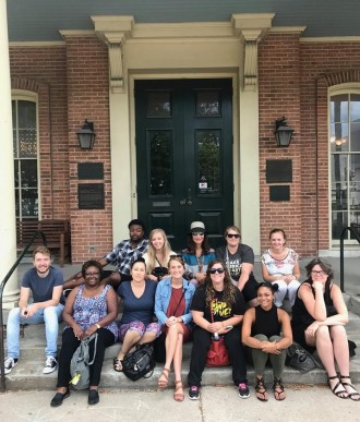 students sitting on steps outside Jane Addams Hull-House