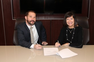 photo of WMU EUP Associate Dean Edwin Martini and Forest Hills Public Schools Assistant Superintendent for Instruction Margaret Fellinger