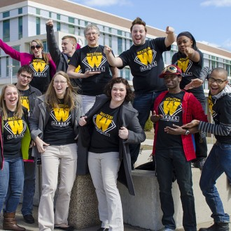 group students and staff wearing Heroes t-shirts and displaying pride on the WMU campus