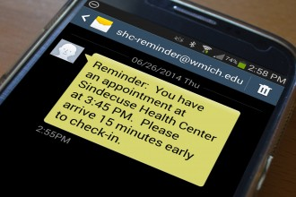 photo of text message reminder on cell phone