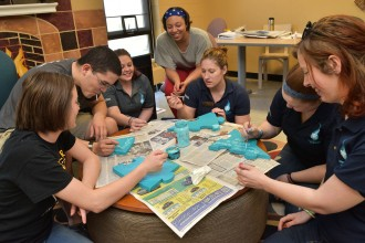 photo of peer educators working on a group activity
