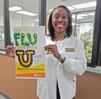 "Nurse holding poster that says ""the flu ends with you"""