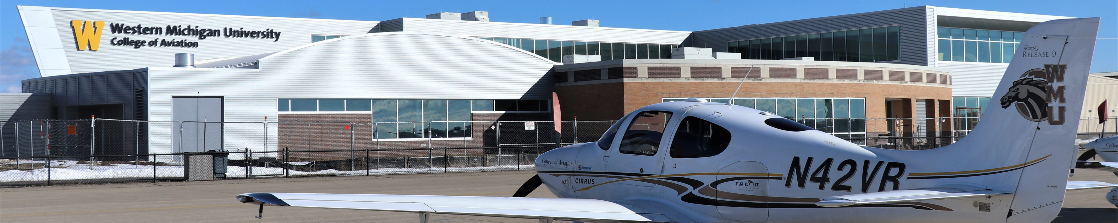AEC outside view with Cirrus airplane.