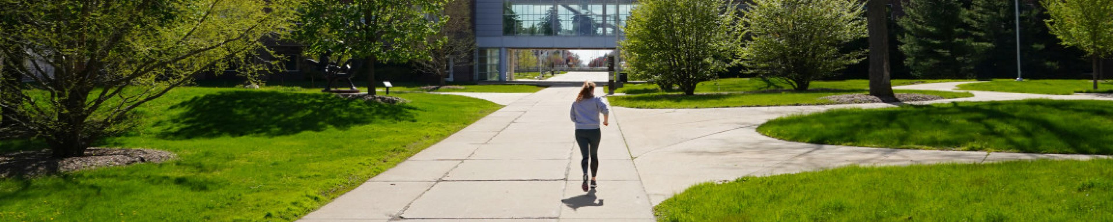 A student runs through campus.