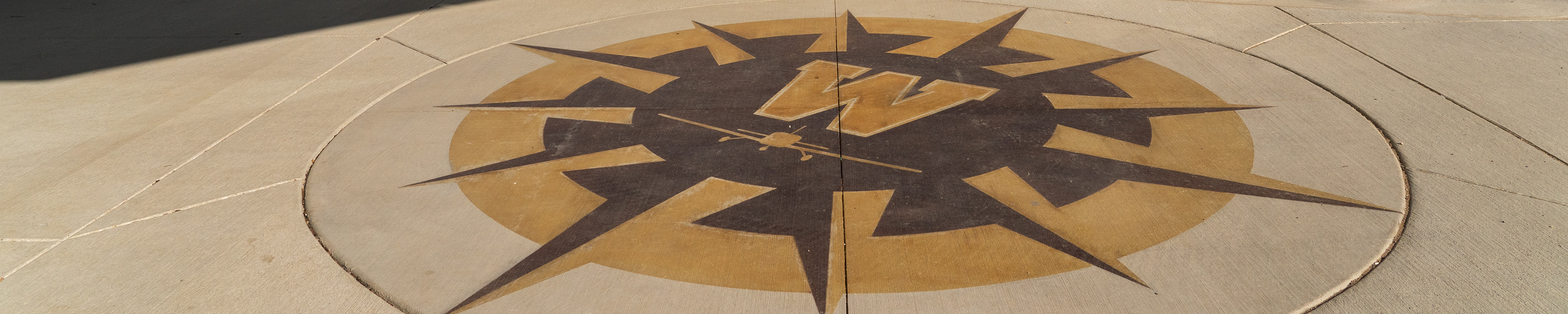 Page banner image: Compass Logo on WMU campus