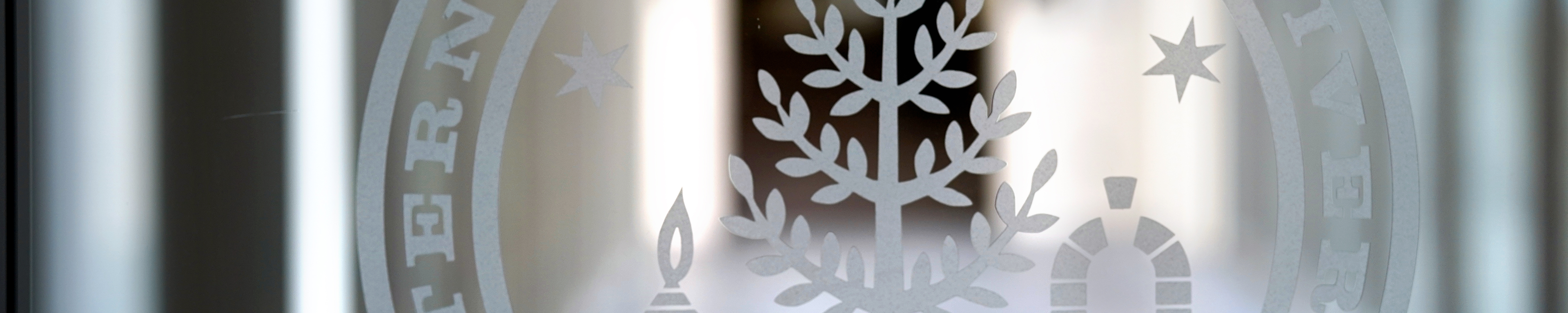 Page banner: WMU seal etched on glass