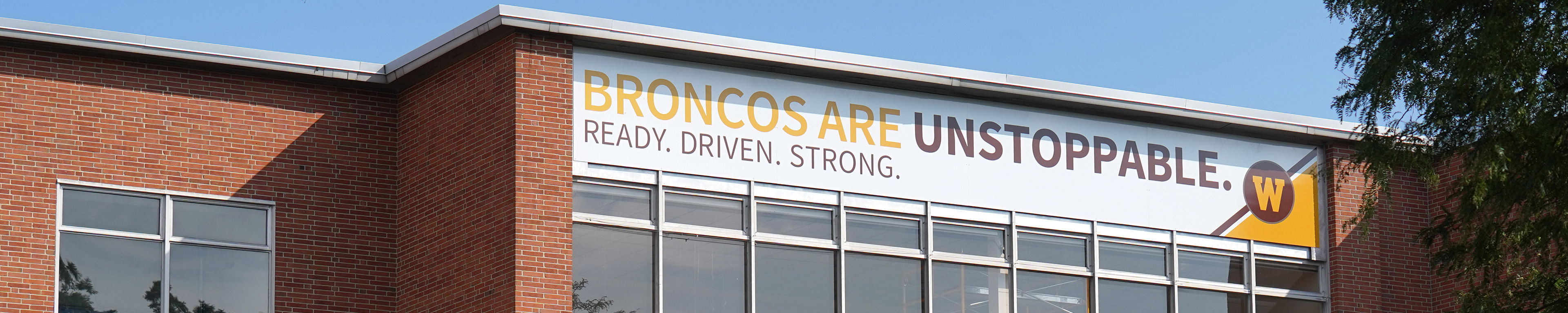 """A poster on campus reading """"Broncos are unstoppable."""""""