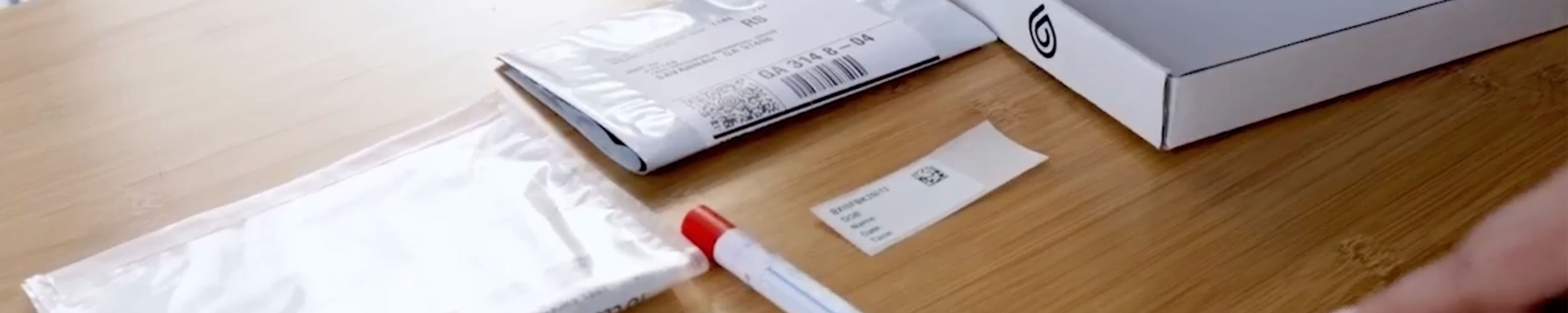 A swab and testing kit on a table.