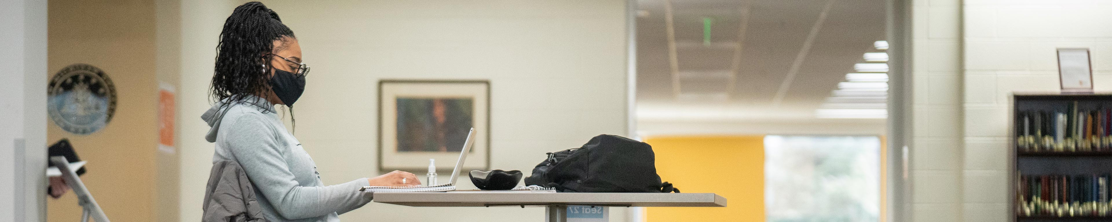 A student studying on a laptop.