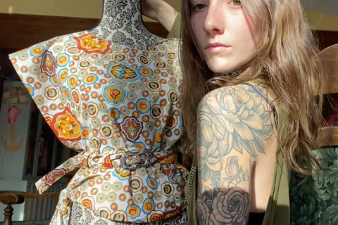Pictured is Rose Soma facing a mannequin covered in fabric