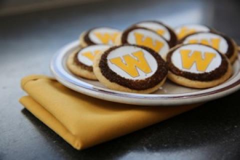 W sugar cookies on plate