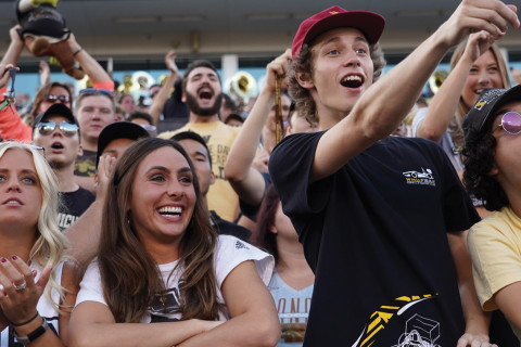 WMU students cheer at a football game at Waldo Stadium