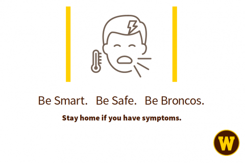 A sign reminding people to stay home if they have symptoms.