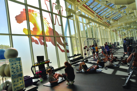 Indoor photo of students working out in the student recreation center