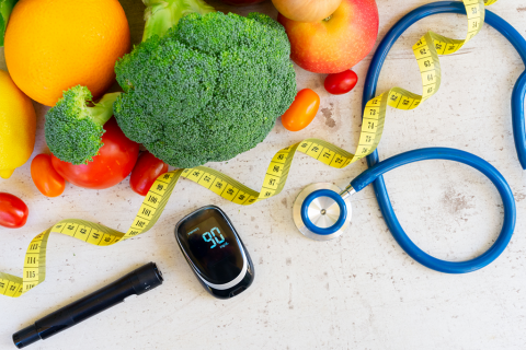 Vegetables, a tape measure, stethoscope and diabetes calculator
