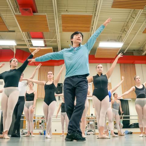 Dance professor teaching a ballet class.