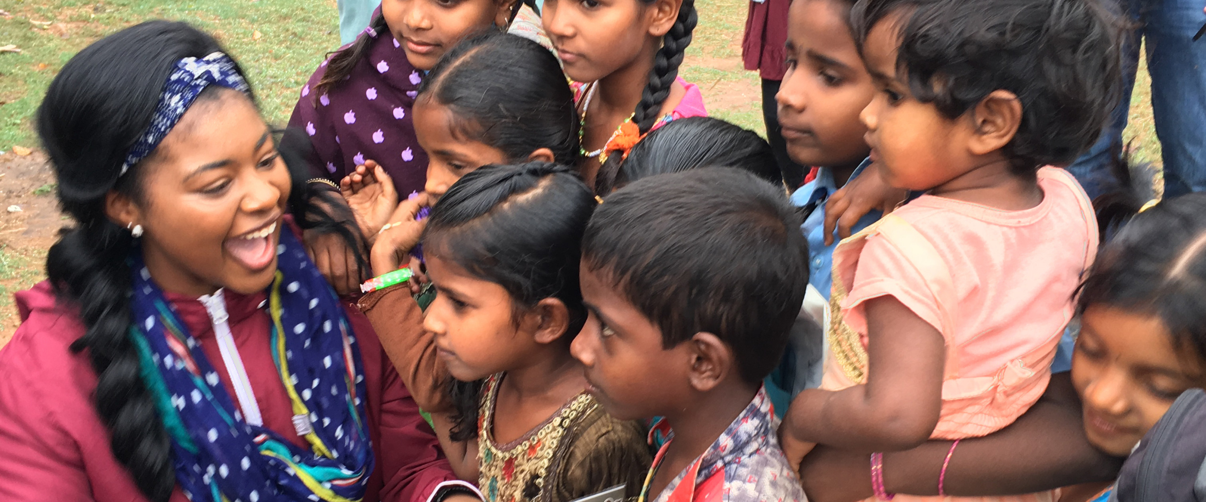 student playing with small children