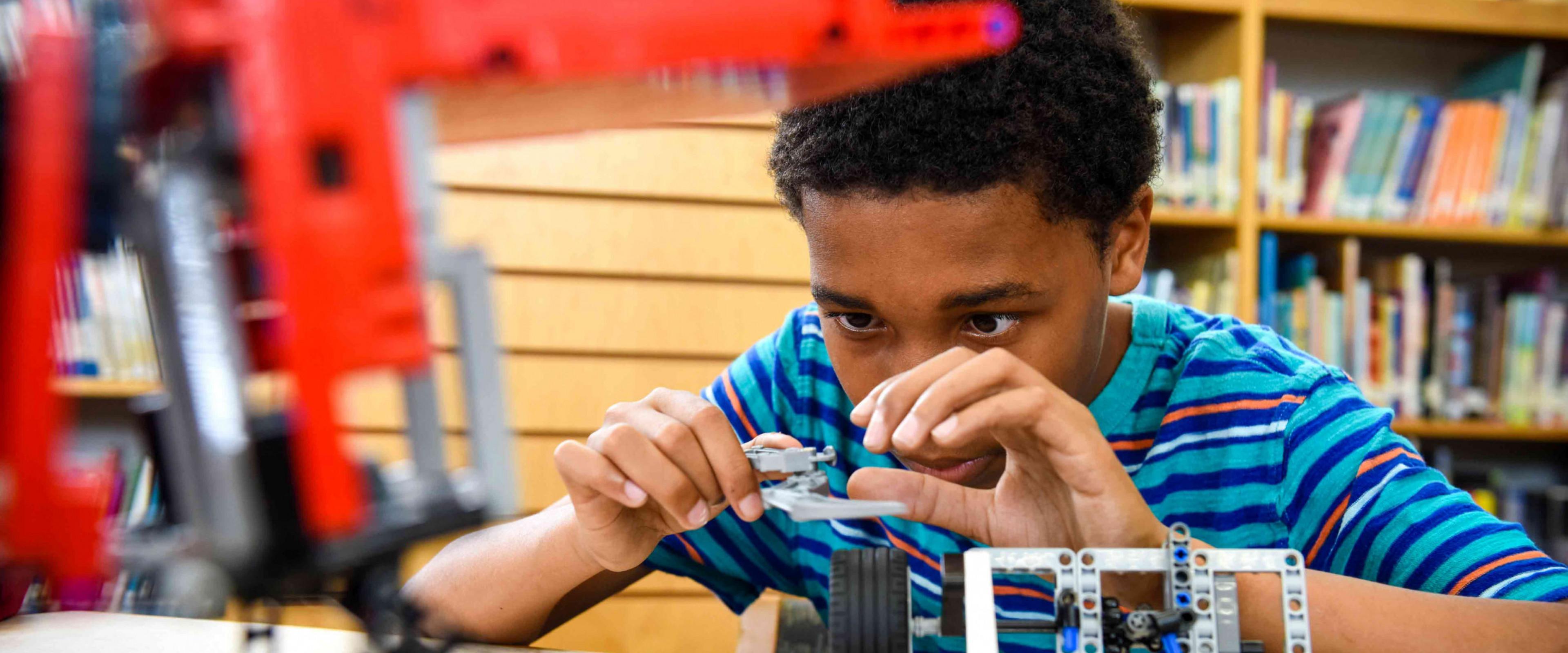 Child working with robotics